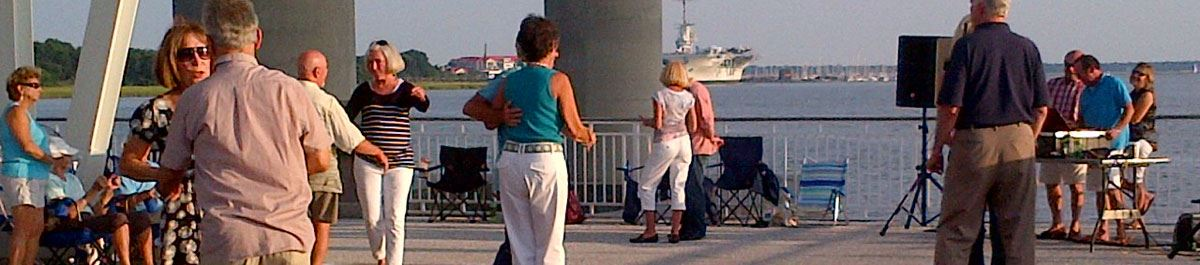 Couples dancing on the Mount Pleasant Pier during Friday Night Boogie