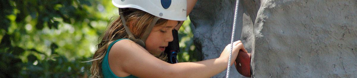 Young girl climbing on the Climbing Wall