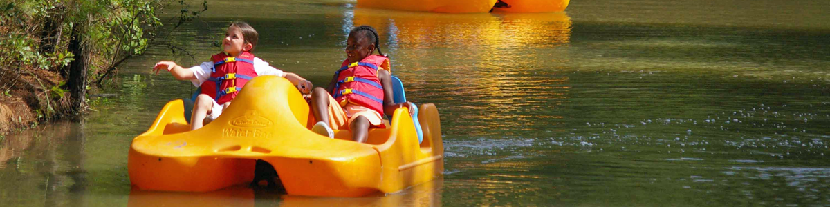 Children in pedal boats at Explorers-Camp