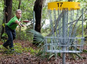 Man throwing a disc at Disc Golf Course at James Island County Park