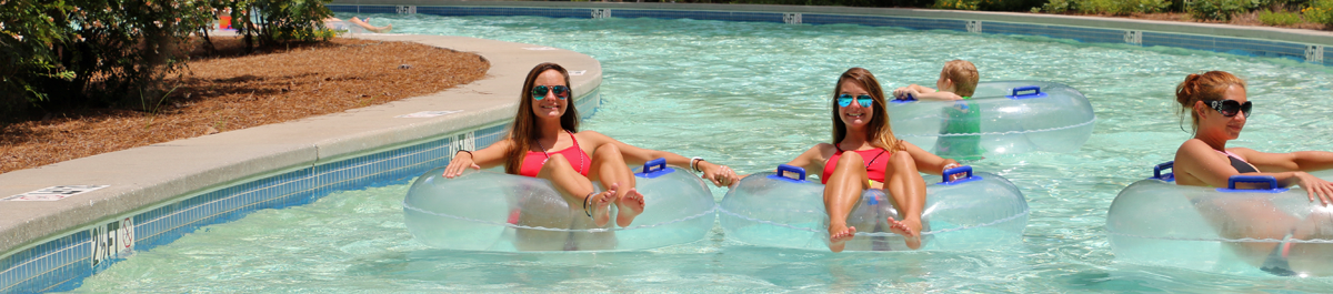 Women floating in the lazy river at Whirlin' Waters
