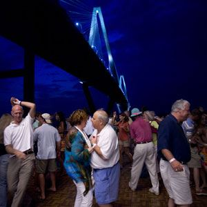 Image of people dancing on the Mount Pleasant Pier during Friday Night Boogie