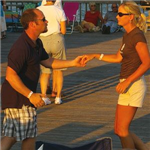 Image of people dancing on the Folly Beach Pier during a Moonlight Mixer