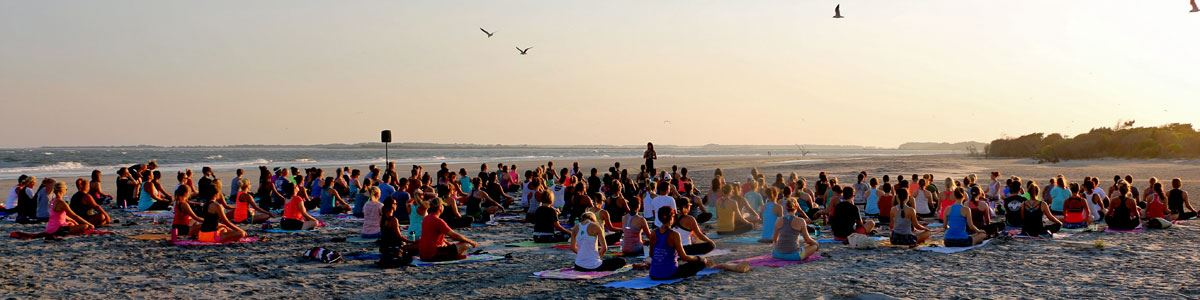 Starlight Yoga participants on the Beach at sunset