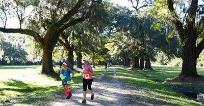 Chili 5K Trail runners under the oak trees at Laurel Hill County Park