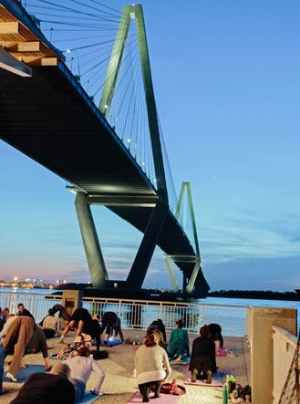 view of the Ravenel Bridge and Charleston Harbor from Starlight Yoga on the Mount Pleasant Pier