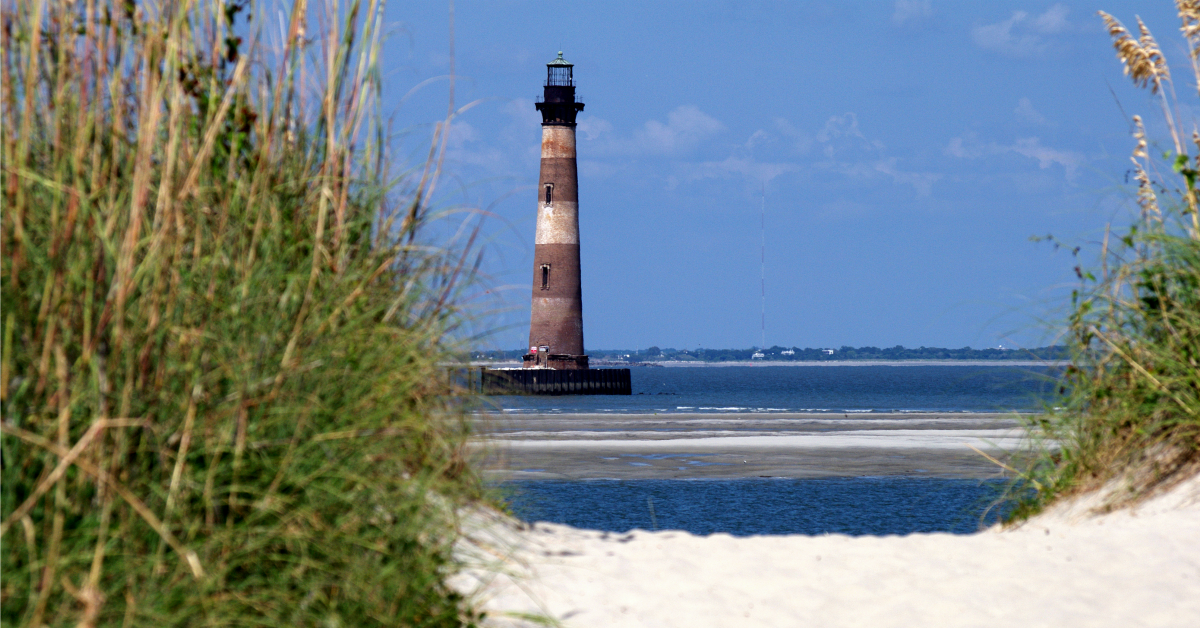 Image of the Morris Island Lighthouse from the beach at Lighthouse Inlet Heritage Preserve
