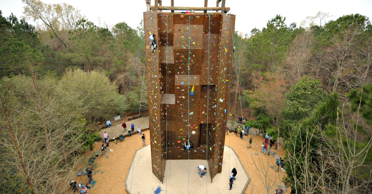 Climbers and spectators at the 50-foot wood climbing wall at James Island County Park