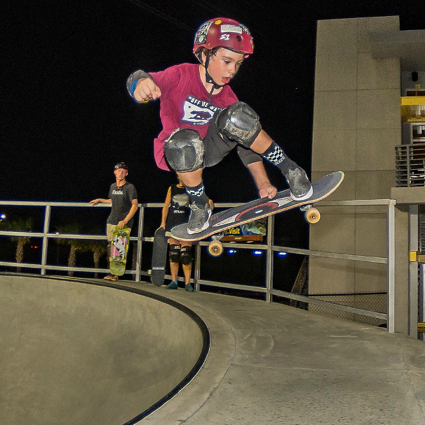 child on a skate board at the skate park