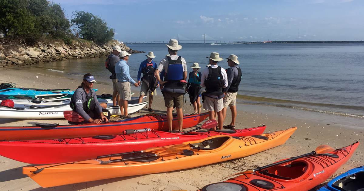 Group of people in a kayaking class