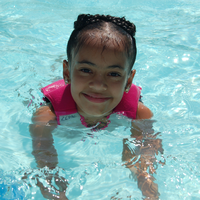 Little girl smiling in the pool