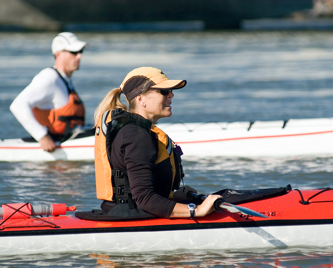 A woman and a man kayaking