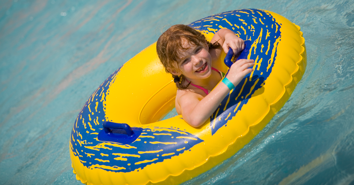 Young girl in an innertube at the waterpark