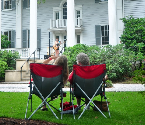 Two people sit in lawn chairs at McLeod Plantation