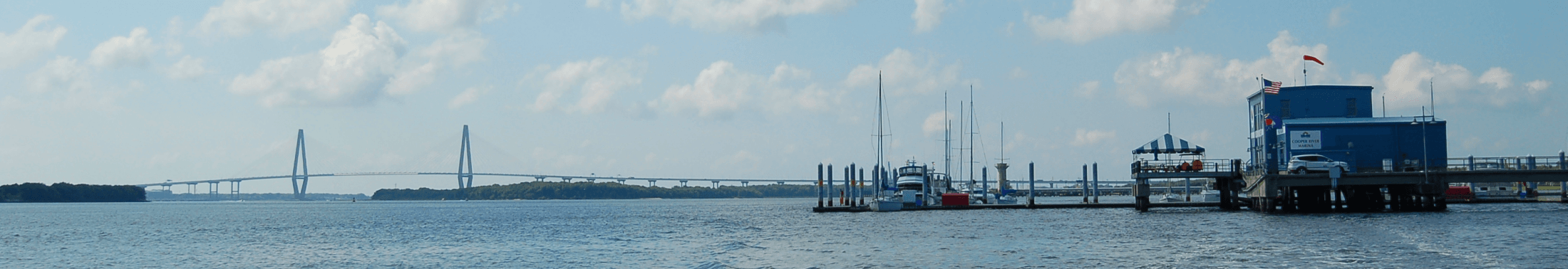 View of the Ravenel Bridge, the water and the marina at Cooper River County Park