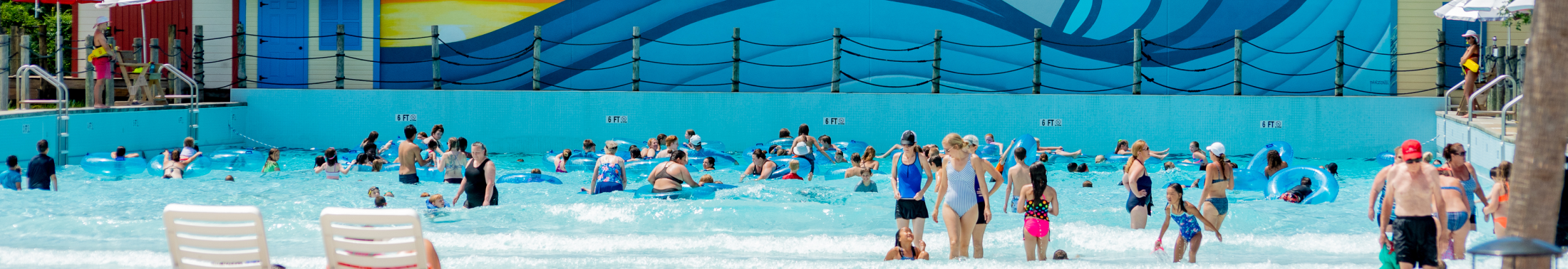 Group of people swim in the pool at Whirlin Waters Adventure Waterpark