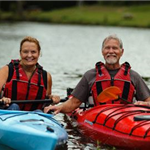 a man and woman in kayaks