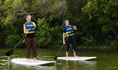 Two women on stand up paddleboards