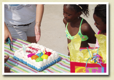 Little girl receiving her birthday cake