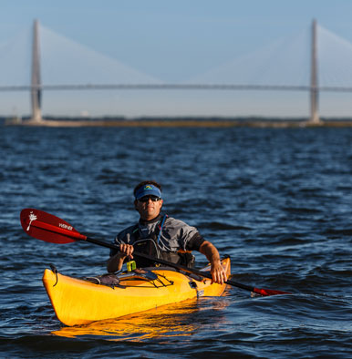 Image of Josh Hall in a kayak in Charleston harbor