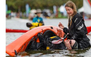 Instructor Helen Wilson with a student in a kayak at the East-Coast-Paddlesports-and-Outdoor-Festiva