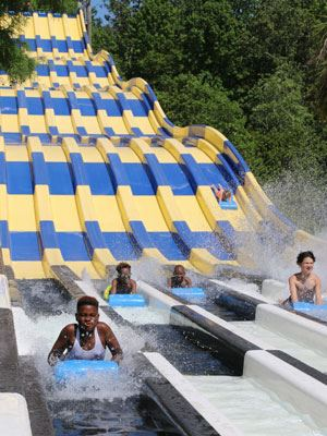 Image of kids racing down the slide at Whirlin' Waters Waterpark