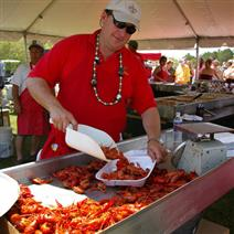 man serving crawfish at the Lowcountry Cajun Festival