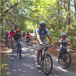 campers riding bicycles