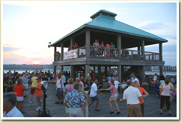 Image of people dancing at the end of the pier